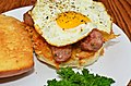 Mmm... fried egg, sliced sausage, and hash browns on a grilled bun (6226666569).jpg