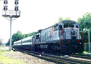 "GE U34CH - U34CH 4164 is painted in NJ Transit's ""Disco Stripe"" paint scheme at Suffern, NY 7/1991"