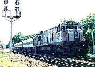 "GE U34CH - U34CH 4164 is painted in NJ Transit's ""Disco Stripe"" paint scheme at Suffern, NY 7/1991"
