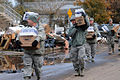New York Air National Guardsmen and New York Army Guardsmen carry water and cases of food to residents in Staten Island, N.Y., on Nov 121101-Z-DV153-132.jpg