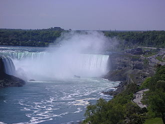 Geography of Canada - The Horseshoe Falls in Niagara Falls, Ontario, one of the world's most voluminous waterfalls, a major source of hydroelectric power, and a tourist destination.