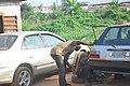Nigerian Mechanic at work.jpg