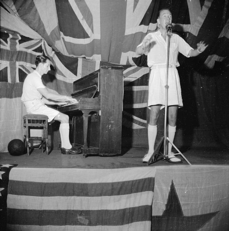 Noel Coward Entertains the Men of the Eastern Fleet, HMS Victorious, Trincomalee, Ceylon, 1 August 1944 A25390