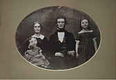 Obed Dickinson with his wife and children.