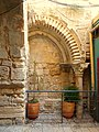Old Jerusalem Bricked up north gate to the Holy Sepulchre right pillar.jpg
