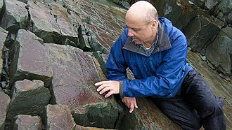 Ediacaran biota - Palaeontologist Guy Narbonne examining Ediacaran fossils in Newfoundland