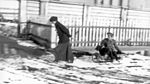 Olga Nikolaevna tows her brother on a sled.jpg