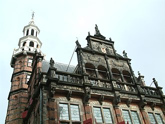 """Jan Baptist Xavery - The statues on the facade of the Old City Hall (The Hague) depicting """"Faith"""", """"Hope"""", """"Love"""", """"Strength"""", and """"Justice"""" were made by Jan Baptist Xavery before 1742."""