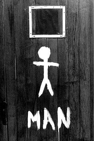 Photo of outhouse door.
