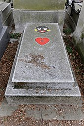Patrick Kelly's grave with an image of a heart and a golliwog on it