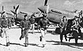 P-40 pilots in the China Burma India theater running to their aircraft in the 1940s, from- Pilots running towards warharks (cropped).jpg