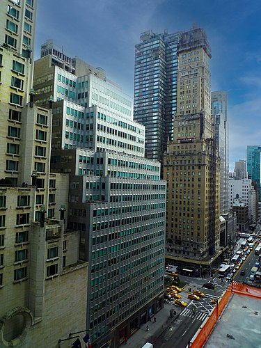 Many tall buildings have setbacks on their facade due to the 1916 Zoning Resolution. This is exemplified at Park Avenue and 57th Street in Midtown Manhattan. Park and 57th street Manhattan New York photo D Ramey Logan.jpg