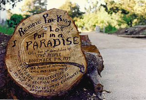 "People's Park (Berkeley) - Unofficial memorial: 25 years of People's Park. ""Remove parking lot, put in a paradise"" is an allusion to Joni Mitchell's song ""Big Yellow Taxi""."