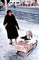 Pereslavl-Zalessky, old woman with child on a sled, 1964.jpg