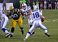Peyton Manning (18) pursued by B.J. Raji (90).jpg