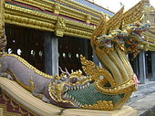 Phra Maha Chedi Chai Mongkol Naga emerging from mouth of Makara.jpg