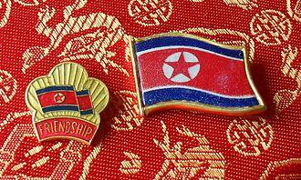 Culture of North Korea - Lapel pins from North Korea