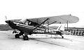 Piper PA-18 sprayer (5287468238).jpg