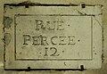 Plaque de nom de rue 18e siècle Paris.jpg