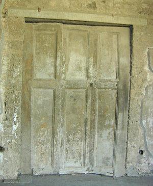 Folding door - Roman folding door at Pompeii, Italy. (1st century AD).