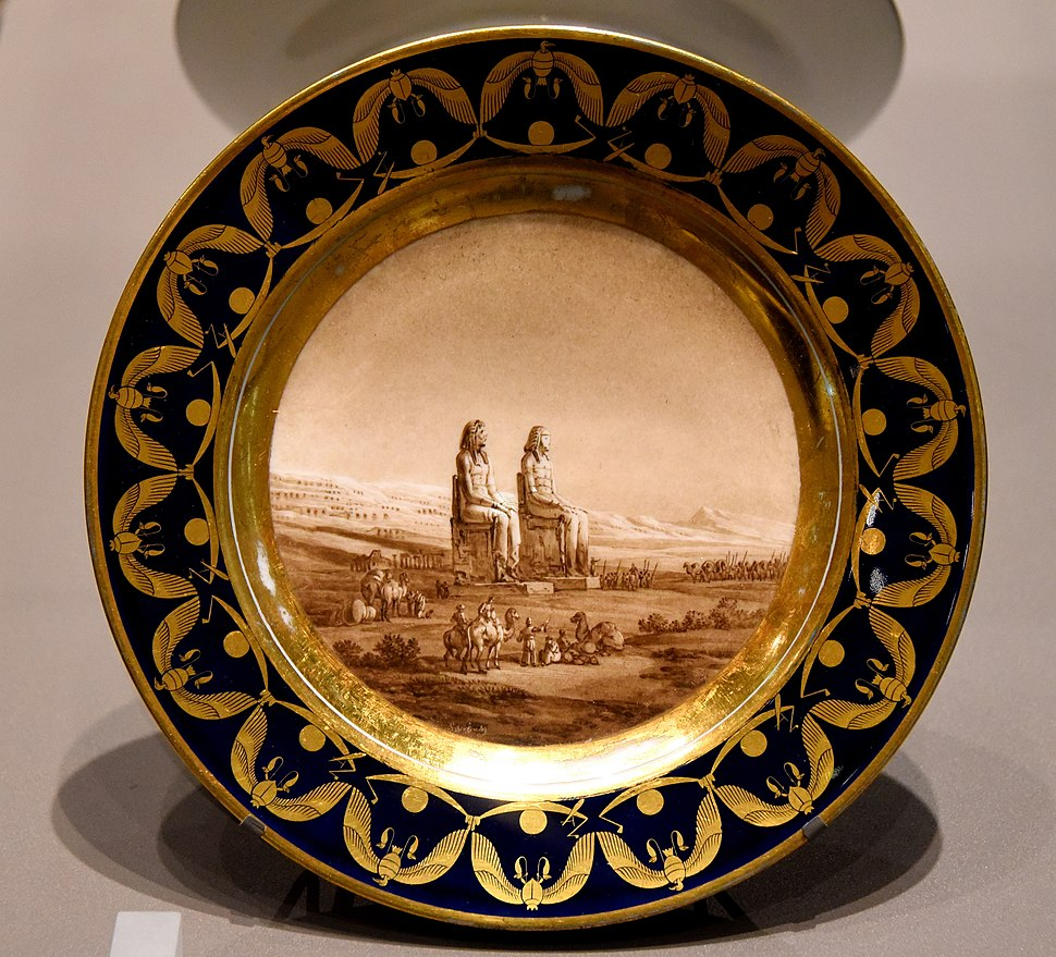 Plate showing statues of Amenhotep III at Luxor, Egypt. Commissioned by Napoleon as a present to Josephine but she rejected it. From France. The Victoria and Albert Museum, London