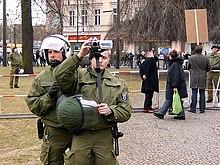 Policemen filming demonstrants.jpg
