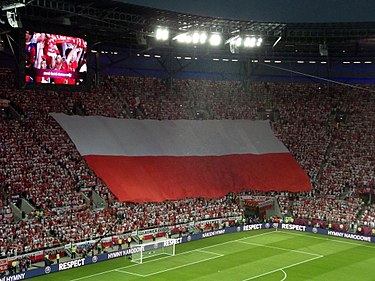 Polish anthem during Czech Republic - Poland, UEFA Euro 2012 Polish anthem and flag.jpg
