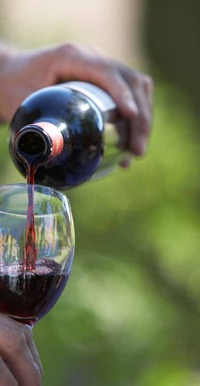 Pouring a glass of red wine.tiff