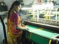 Power loom handling woman.JPG