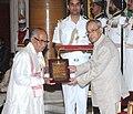 Pranab Mukherjee presenting the Sangeet Natak Akademi Award-2014 to Shri Reba Kanta Mahanta, in the field of Mask-Making.jpg