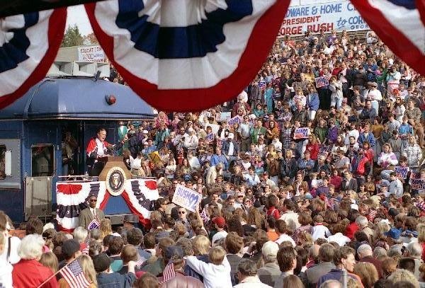 """President Bush addresses supporters from the back of his """"Spirit of America"""" railroad car in Cornelia during on his whistlestop train tour across Georgia"""
