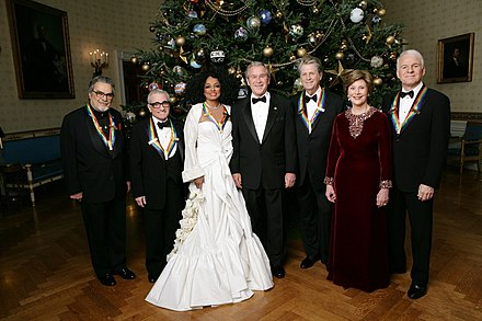 Leon Fleisher, Martin Scorsese, Diana Ross, Brian Wilson and Steve Martin with President George W. Bush and Laura Bush in 2007 President George W. Bush and Mrs. Laura Bush stand in the Blue Room of the White House.jpg