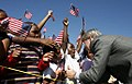 President George W. Bush greets flag-waving students at the Waldo C. Falkener Elementary School Wednesday, Oct. 18, 2006.jpg