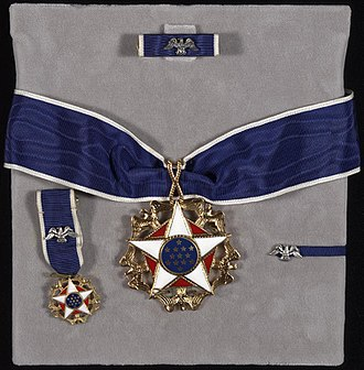 Presidential Medal of Freedom - Medal and accoutrements including undress ribbon, miniature, and lapel badge.