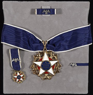 Medal and accoutrements including undress ribbon, miniature, and lapel badge Presidential-medal-of-freedom.jpg