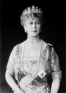 Mary in tiara and gown wearing a choker necklace and a string of pearls