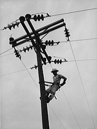 Rural electrification - A Rural Electrification Administration lineman at work in Missouri, United States in 1942