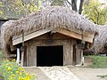 RO B Village Museum Draghiceni mud hut entrance.jpg