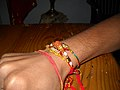 Rakhi tied to a man's wrist Hindu Festival celebrated in Mauritius.jpg