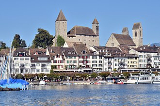 Rapperswil Castle - Rapperswil harbour, as seen from Seedamm, Fischmarktplatz to the right, Rapperswil castle and ''Stadtpfarrkirche'' (St. John's Church) in the background (September 2014)