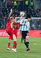Raul Meireles (L), Ever Banega (R) – Portugal vs. Argentina, 9th February 2011 (1).jpg