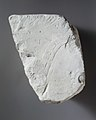 Relief fragment- foreigner with feather in his hair and Nubian MET EG98.jpg