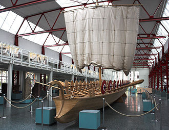 Revolt of the Batavi - Reconstruction of a Roman fluvial boat of the classis germanica (Rhine flotilla). It is based on the remarkable discovery of the remains of five Roman boats at Mainz in the early 1980s. The boat above, denoted Mainz Type A, was designed as a rapid intervention launch, with long, narrow shape and shallow keel. It would be rowed by the troops themselves (32 oars, 16 on each side). Note the mounted shields to protect the oarsmen from missiles shot from the riverbanks. At the time of Civilis' revolt (69 AD), most such boats were manned by Batavi crews. 4th century. Museum für Antike Schifffahrt, Mainz, Germany