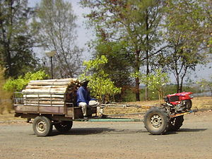 Two-wheel tractor - A Rot-E-Taek hauling logs in Isan, Thailand. This is one of many types of two-wheel tractor.