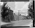 SHOWING ROW OF BRICK HOUSES ALONG CAR TRACKS - Street Scene, Columbia, Monroe County, IL HABS ILL,67-COLUM,14-1.tif