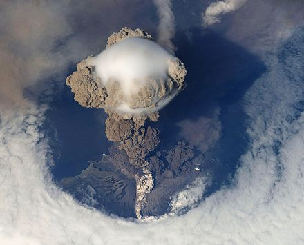 The Sarychev volcano erupting on June 12, 2009, as seen from the International Space Station. Sarychev Volcano edit.jpg