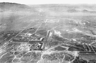 Sandia Base - Kirtland Army Air Base (now Kirtland Air Force Base) is seen in the foreground of this 1945 photograph. Looking east, Sandia Base is in the background.