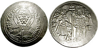 Roger II of Sicily - AR Scyphate Ducalis, dated year 10 (1140), after the king's victory on July 25. Obverse: Christ. Reverse: King Roger and Duke Roger.