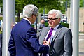 Secretary Kerry Chats With German Foreign Minister Steinmeier on the Front Lawn of NATO Headquarters in Brussels (27045697051).jpg