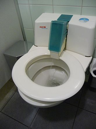 Automatic self-clean toilet seat - A CWS Seat Cleaner during cleaning operation. October 2010